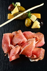 Platter of serrano jamon/Prosciutto and olives pate