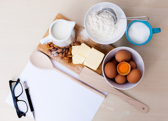 recipe and baking ingredients with glasses
