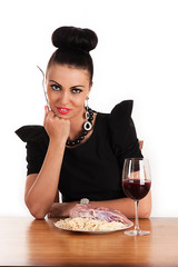 smiling woman eating raw meat with macaroni