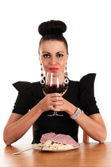 luxury woman holding a glass of blood
