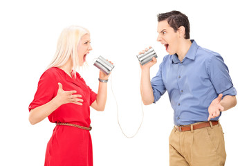 Couple arguing through a tin can phone