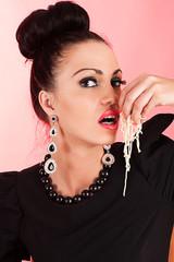 woman eating macaroni hands
