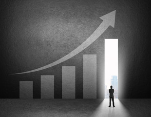 Businessman stand in front of the growth chart on the wall