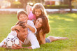 canvas print picture - Family Lying In Pile Up On Grass Together