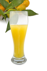 glass of juice and tangerine