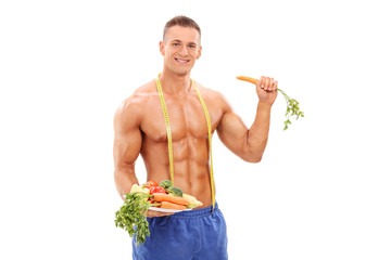 Young athlete holding a plate with vegetables