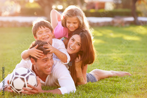 canvas print picture Family Lying In Pile Up On Grass Together