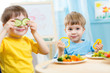 kids eating in kindergarten - 75742822