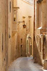 Lantern in ancient narrow street of Mdina, Malta