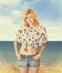 beautiful smiling girl in denim shorts