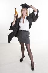 Mature university student holding beer bottle