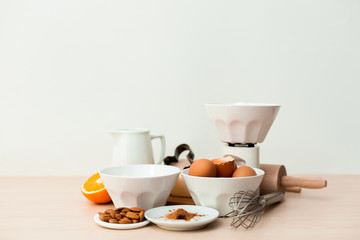 Bake ingredients on a wooden board and white background