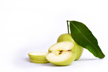 Green apples cut in slices and leaves, macro detail isolated