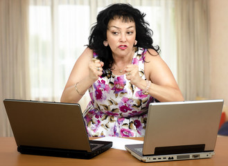 Angry mature woman clenching her fists