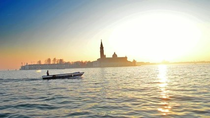 boat sailing in Venice at sunset