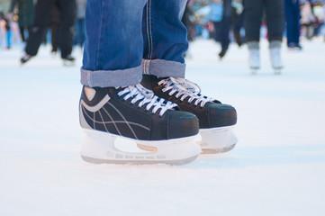 Legs of skater on winter ice rink
