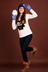 Happy teenager girl with snowball