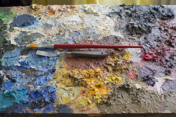 Little trowel and brush on oil colors palette