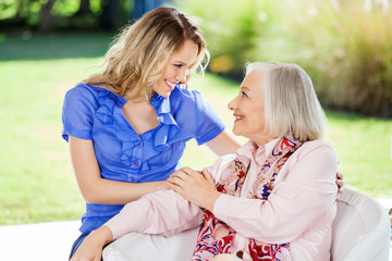 Affectionate Granddaughter And Grandmother At Nursing Home Porch