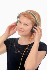 Playful woman wearing headphones