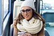Young beautiful woman using her mobile phone on a  bus. - 75750057