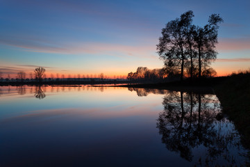 Flooded countryside at sunset