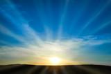 Fototapety Sun rising on the blue sky