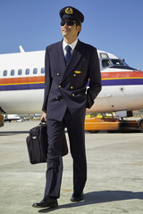 Italy, Sardinia, Olbia Airport, male flight assistant unboarding