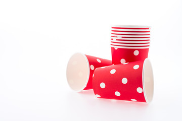 Red polka dot paper cup isolated on white background