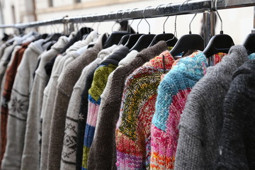 wool sweaters and vintage clothes for sale in open-air flea mark