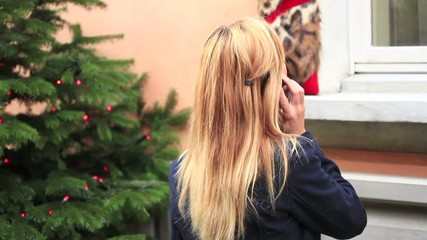 Woman shopping talking on the phone-Christmas