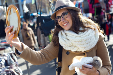 Young beautiful woman shopping in a market.
