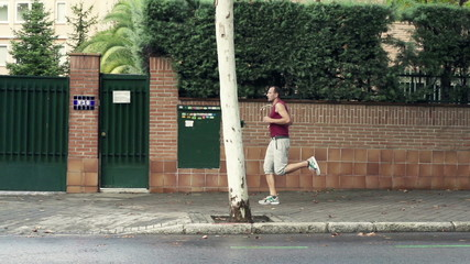 Handsome man jogging in city,