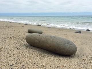 Stein am Strand vom Ozean