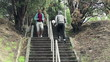 Two men jogging the stairs in park,