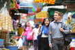 Tourists shopping in street market in Hong Kong - 75753056