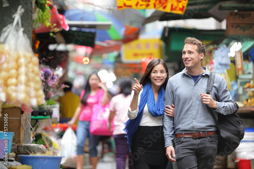 Tourists shopping in street market in Hong Kong Poster