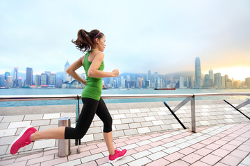 City Running - woman runner and Hong Kong skyline