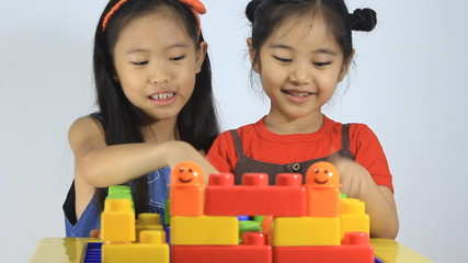 Little Asian children playing with blocks