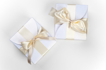 White boxes with gold bow