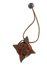 Zodiac sign Pisces in the form of a wooden charms on a leather s