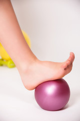 Foot rolling on a ball