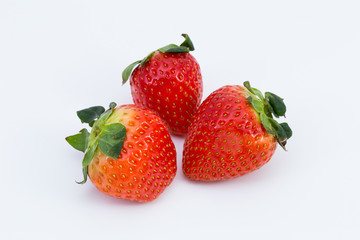 Fresh sweet ripe strawberries on a white background