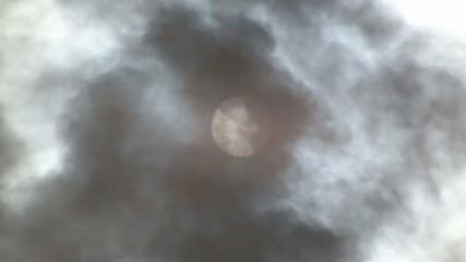 sun against a cloud