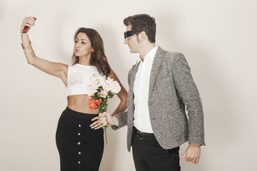 Man offering a bouquet to a woman who ignores him