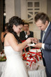 Beautiful young bride feeding wedding cake to groom