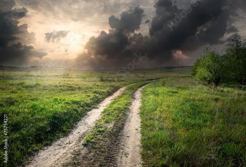 Leinwanddruck Bild Lightning over road
