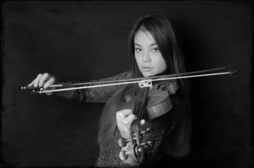 young asian woman playing violin