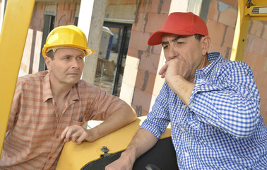 Construction site colleagues having a chat