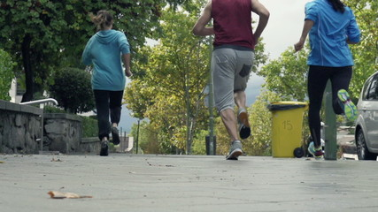 Young people jogging in city, slow motion shot at 240fps
